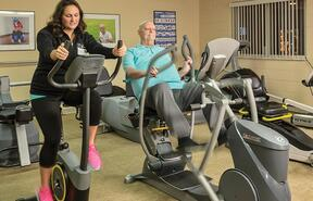 Caroline Rapier and a St. Paul Village resident in the Fitness Zone.