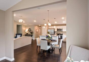 The Cumberland open-concept living and dining room at Dudley Square
