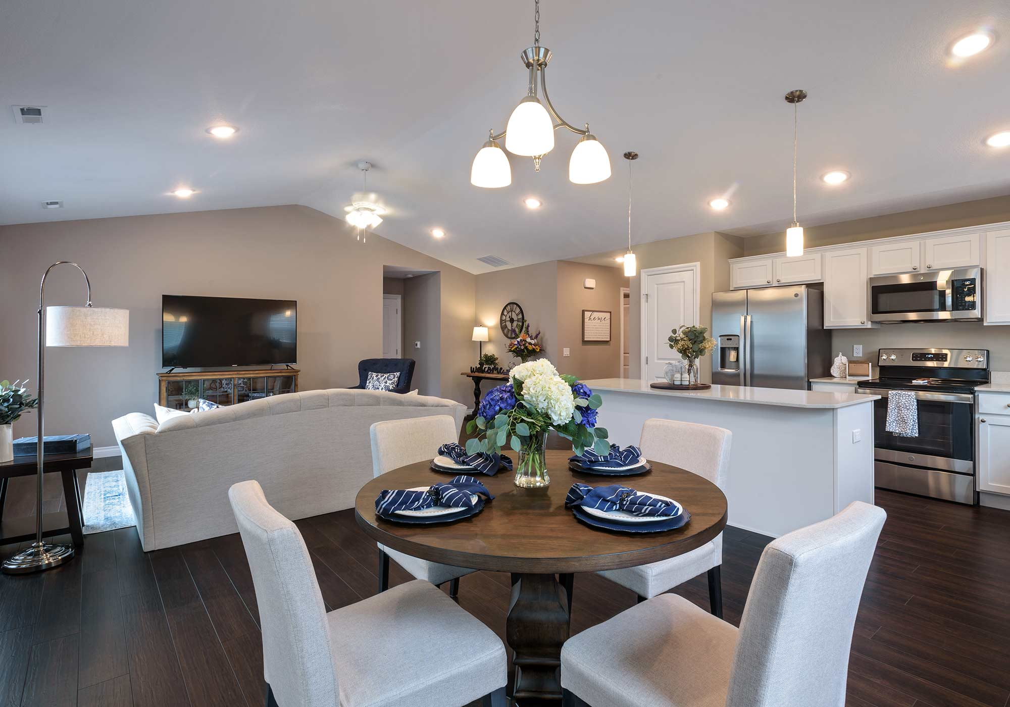 The Cumberland open-concept living and dining room at Dudley Square Episcopal Church Home