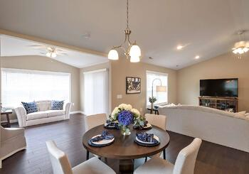 The Cumberland open-concept dining and living room with sunroom at Dudley Square Episcopal Church Home