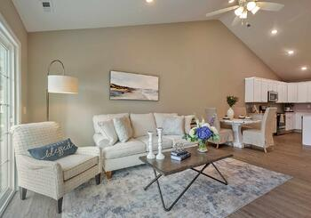 The Herrington open-concept living room at Dudley Square
